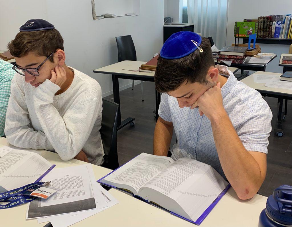 """Yeshiva students studying """"The Israel Bible"""""""