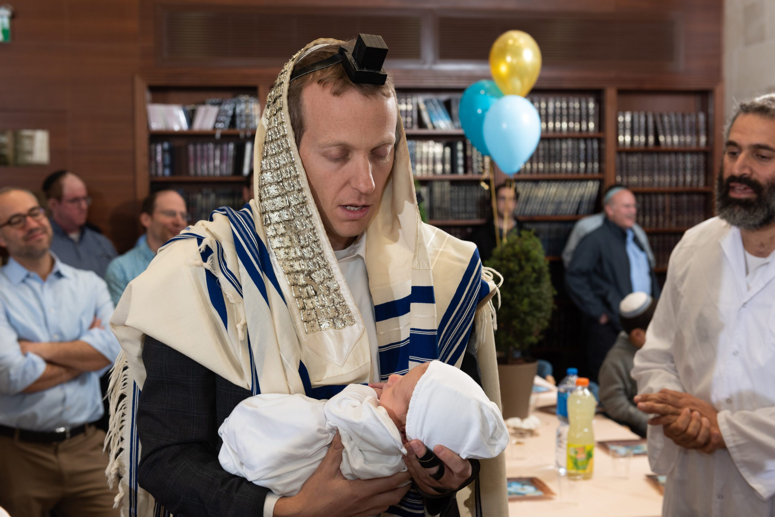 Rabbi Tuly Weisz entering his son into the Brit Milah, the Covenant of Circumcision